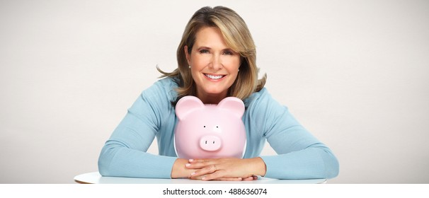 Senior woman with a piggy bank.