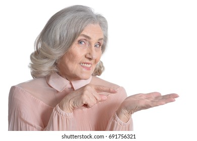 senior woman in pink blouse