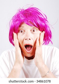 Senior woman with pink hair and facial gesture