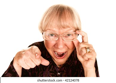 Senior woman pointing her finger and laughing