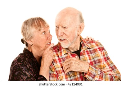 Senior woman pointing her finger and husband