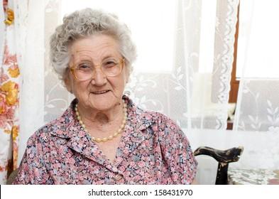 Senior woman portrait in her room