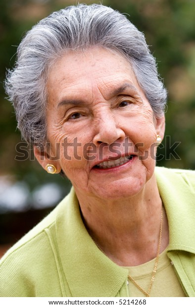 senior woman portrait smiling at her home