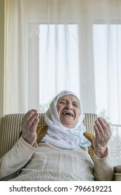 A senior woman praying