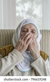 A senior woman praying