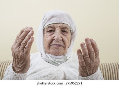 senior woman praying according to the islam