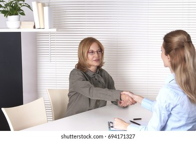 Senior woman and psychologist handshake