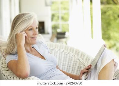 Senior woman reading outside