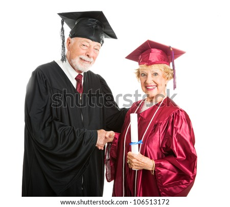 0388b4eed6 Senior woman receives her diploma at graduation ceremony. Isolated on white.