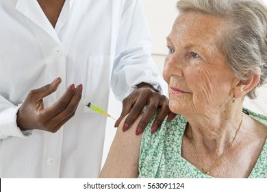 senior woman receiving vaccine