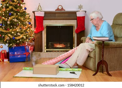 senior woman remembering her cat at christmas time