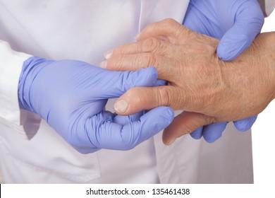 Senior woman with rheumatoid arthritis visit a doctor Isolated on white