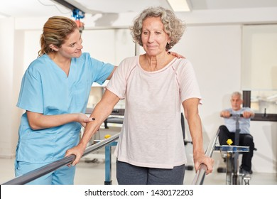 Senior woman in running training together with physiotherapist in rehab