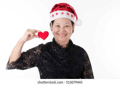 Senior woman in santa cap over white background