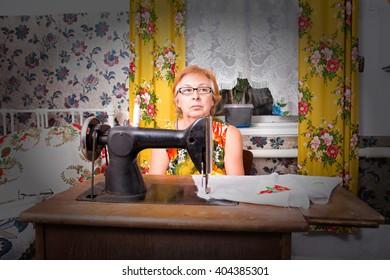 Senior woman at sewing machine