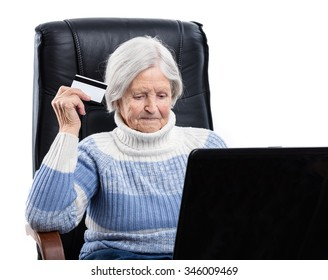 Senior woman shopping online and paying with a credit card