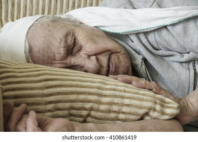 senior woman sleeping on sofa