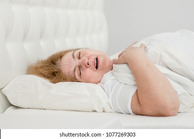 senior woman sleeping and snoring on the bed