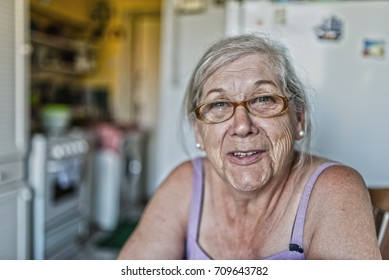 senior woman smiling at camera. Face of a happy senior woman in her 70s
