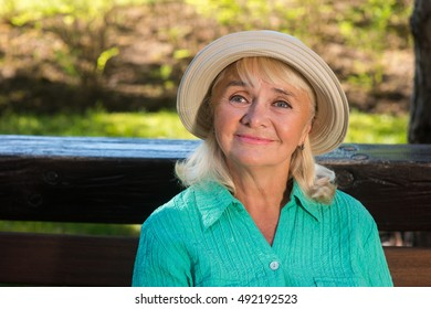 Senior woman is smiling. Lady wearing a hat. Life is wonderful. Kindness that comes from heart.