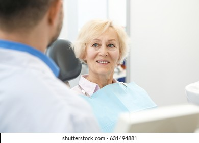 Senior woman smiling listening to her dentist during consultation copyspace elderly seniority pensioner patient insurance medicine healthcare discount support helping helpful doctor treatment
