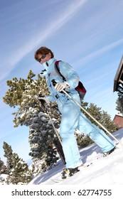 Senior woman snowshoeing