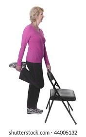 Senior woman stretching with chair