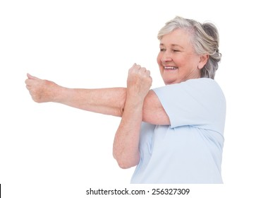 Senior woman stretching her arms on white background