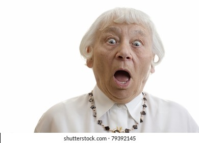Senior woman studio portrait gasping shocked