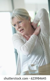Senior woman suffering arthrosis