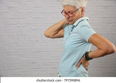 Senior Woman suffering from back and neck pain. Chiropractic, osteopathy, Physiotherapy. Alternative medicine, pain relief concept.