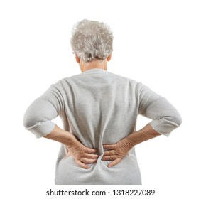 Senior woman suffering from back pain on white background