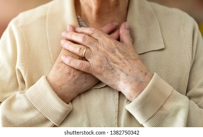 Senior Woman Suffering From Chest Pain