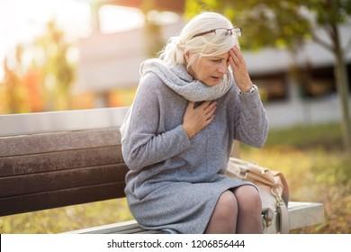 Senior woman suffering from a headache