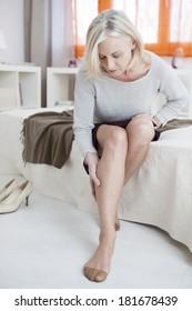 Senior woman suffers from leg pain