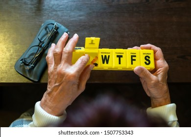 Senior woman take pills from box. Healthcare and old age concept with medicines. Medicaments on table.