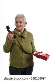 Senior woman talking on old phone