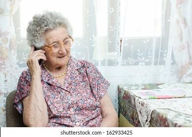 senior woman talking on phone indoor