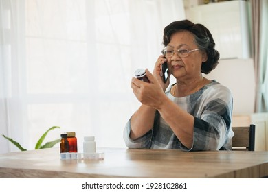 Senior woman talking on a phone and looking at the label on a medication bottle to ask about label and instructions side effects. Old woman taking care herself for health. Health and Medical concept.