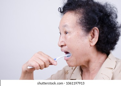 Senior woman teeth brush