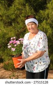 A Senior woman tending to a garden