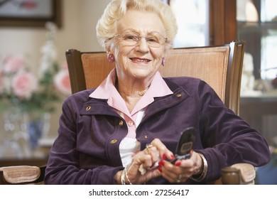 Senior woman text messaging