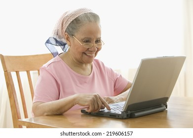 Senior woman typing on laptop
