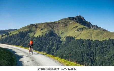 senior woman underway on her electrical mountain bike to the summit of Kitzbuehler Horn, Tirol,Austria