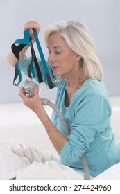 Senior Woman Using CPAP machine