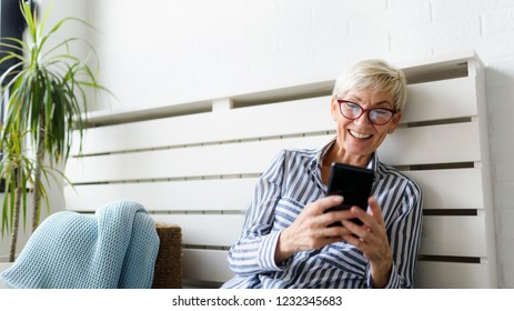 Senior woman using digital tablet at home. The use of technology by the elderly