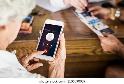 Senior woman using her phone