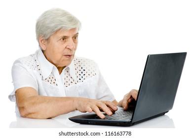 senior woman using laptop. isolated on white background