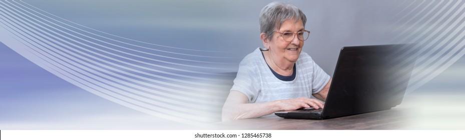 Senior woman using a laptop. panoramic banner
