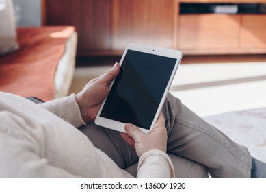 Senior woman using tablet